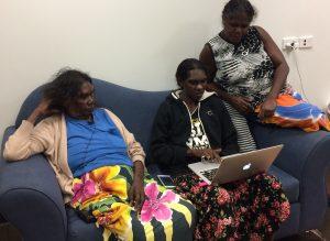 Talena Wilton (centre) transcribing a story by her kakkak 'mother's mother', Millie Djamuddjana, with help from Millie (L) and Sandra Makurlngu (R).