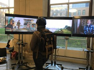 A visitor watches the video installation created by Chouette Films.