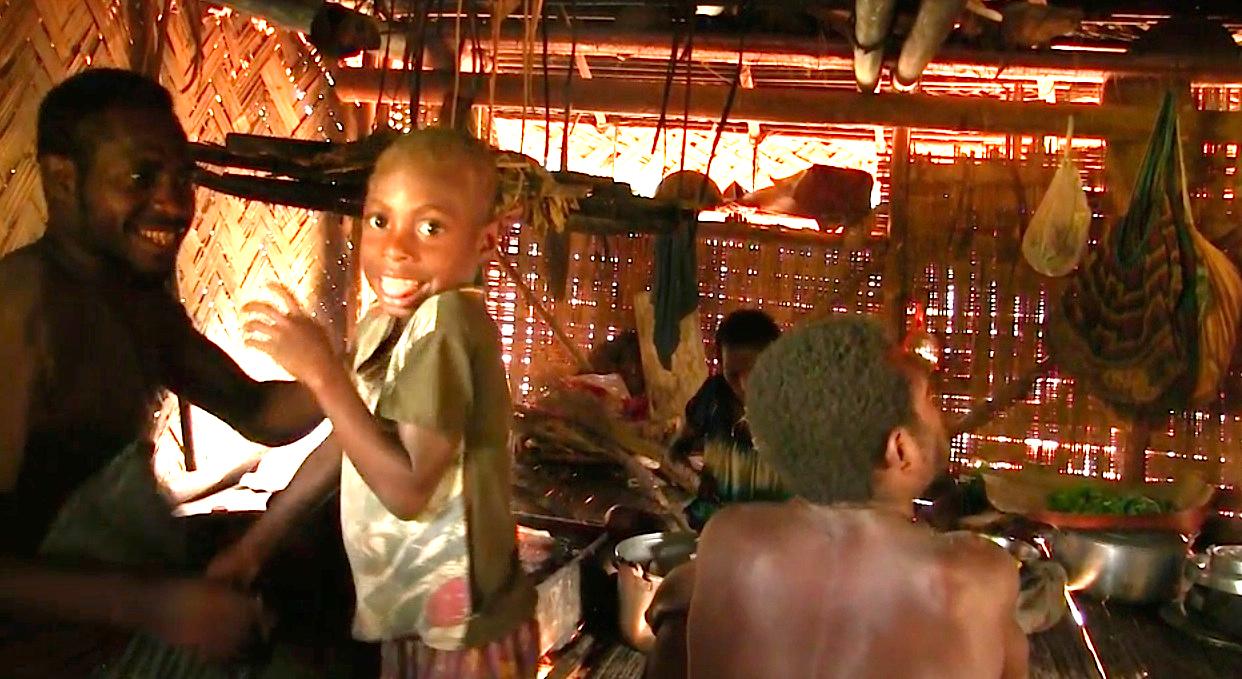 Matthew Guku, his nephew Berden Mhiti, Wesli Guku and Dorothy Guku. During a video recording of a morning meal in Dorothy's kitchen. Akapmɨŋgɨ hamlet, Andamang village, Madang Province, Papua New guinea.